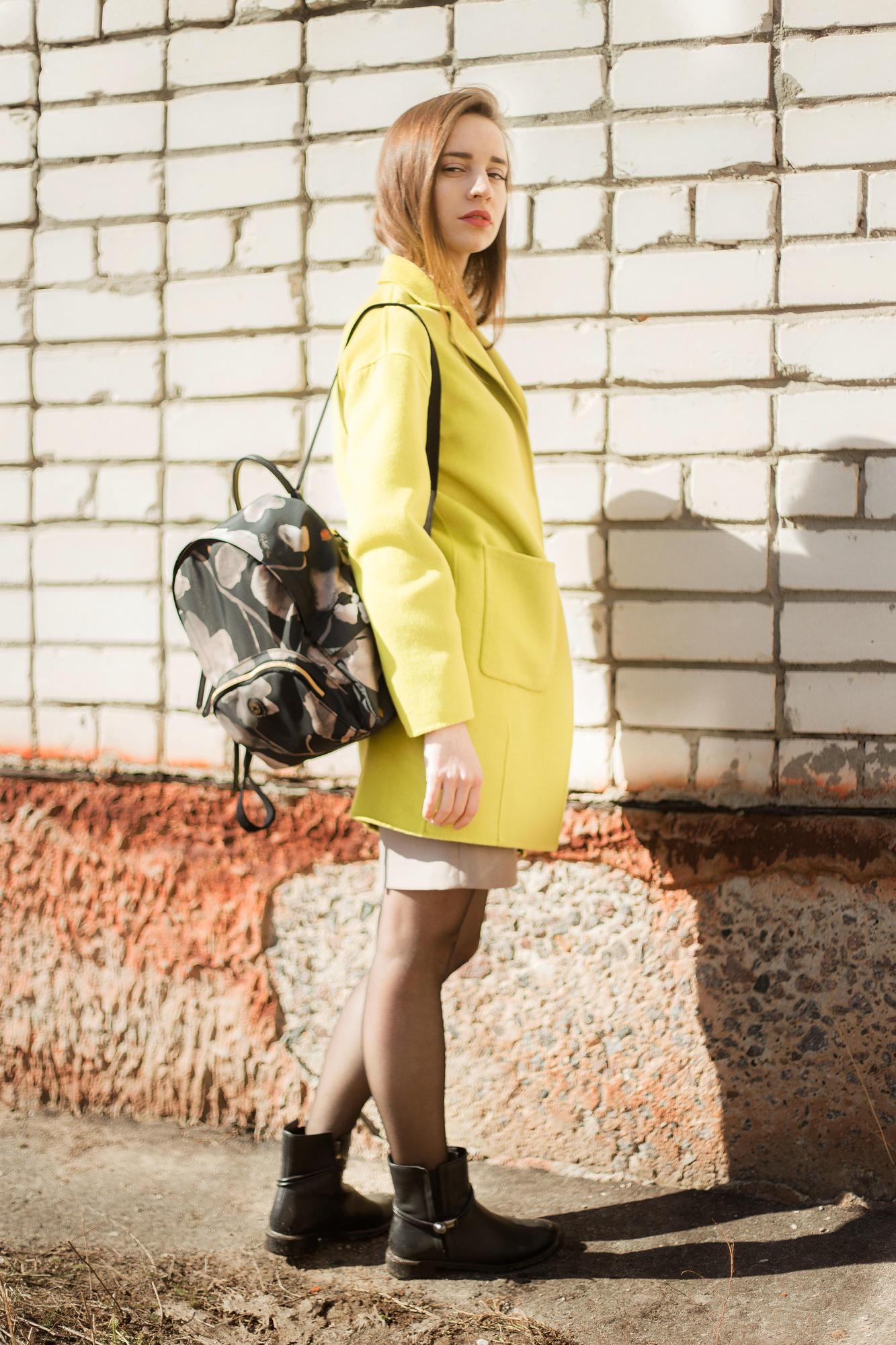 girl in lime coat